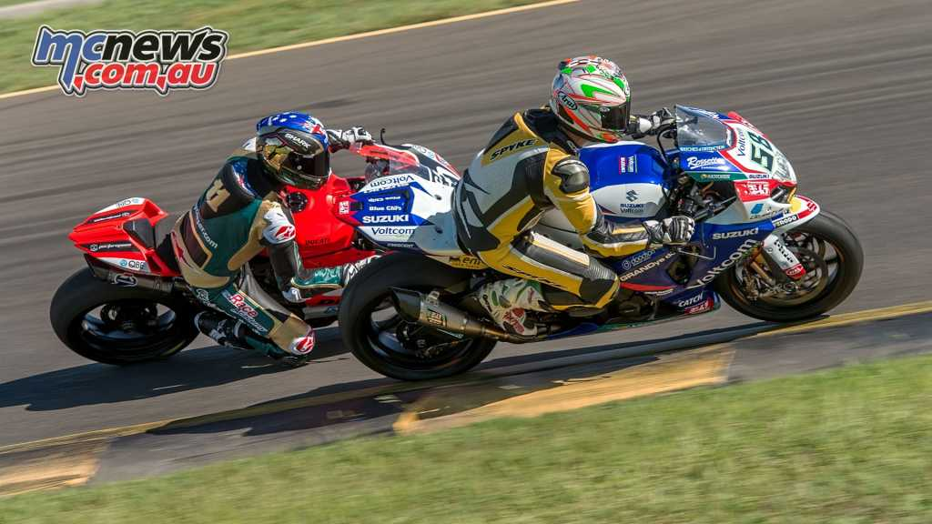 Troy Corser and Franki Chili on the race winning Voltcom Suzuki ridden by Eugene Laverty in the WSBK