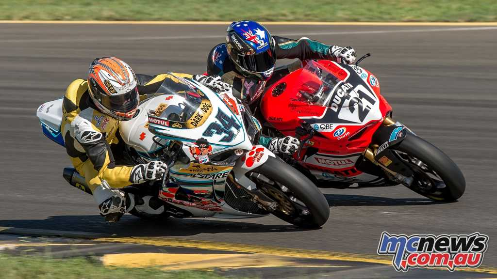 Troy Corser duking it out with Jeremy McWilliams
