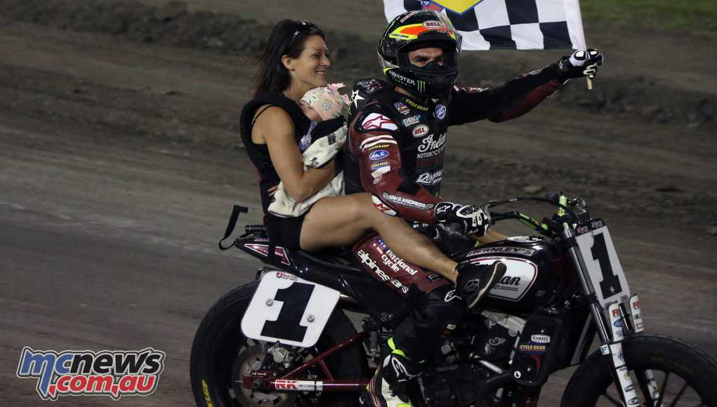Jared Mees celebrates with a lap with his wife and daughter on the bike