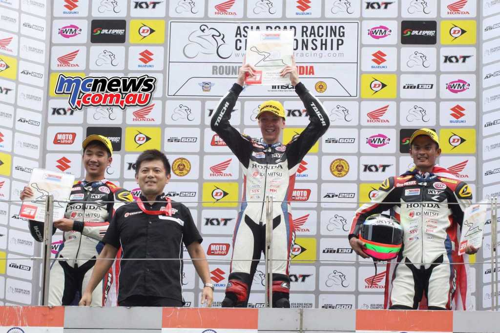 Broc Pearson on top of the podium in 2016 after taking an Asia Dream Cup race victory in India