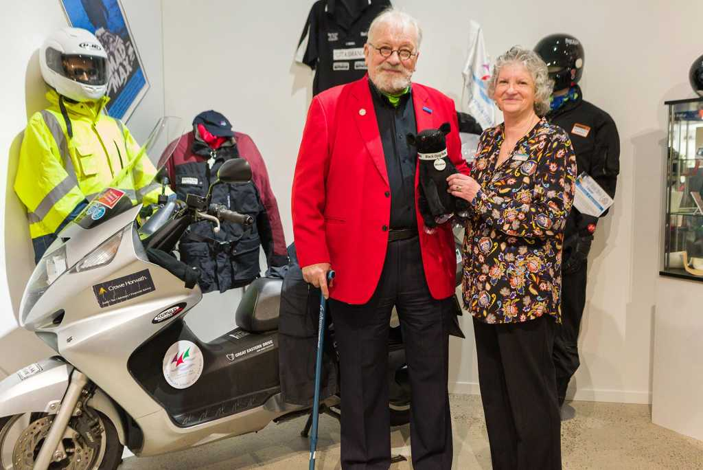 Bertrand regretfully hands over the Honda SilverWing to the director of the East Coast Heritage Museum. The scooter has 65,000km on the clock. Image by Martin, Madhouse Photography