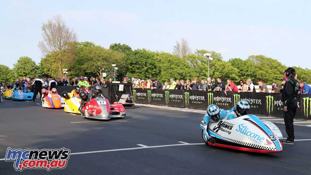Sidecars heading out for their controlled speed lap