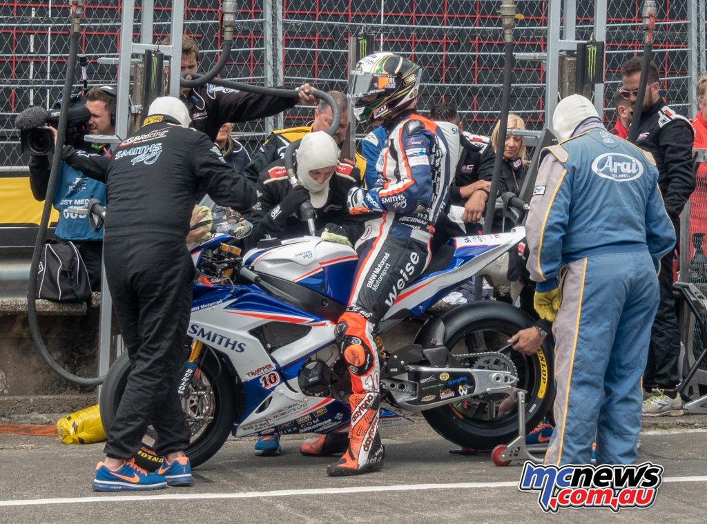 Peter Hickman in for fuel and a new rear tyre after lap two of the six-lap Senior TT