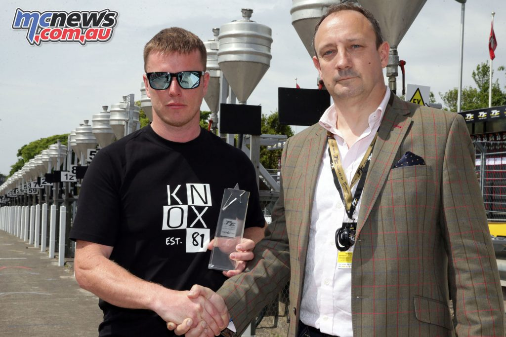 Ryan Kneen being presented with the award by Guy Templer