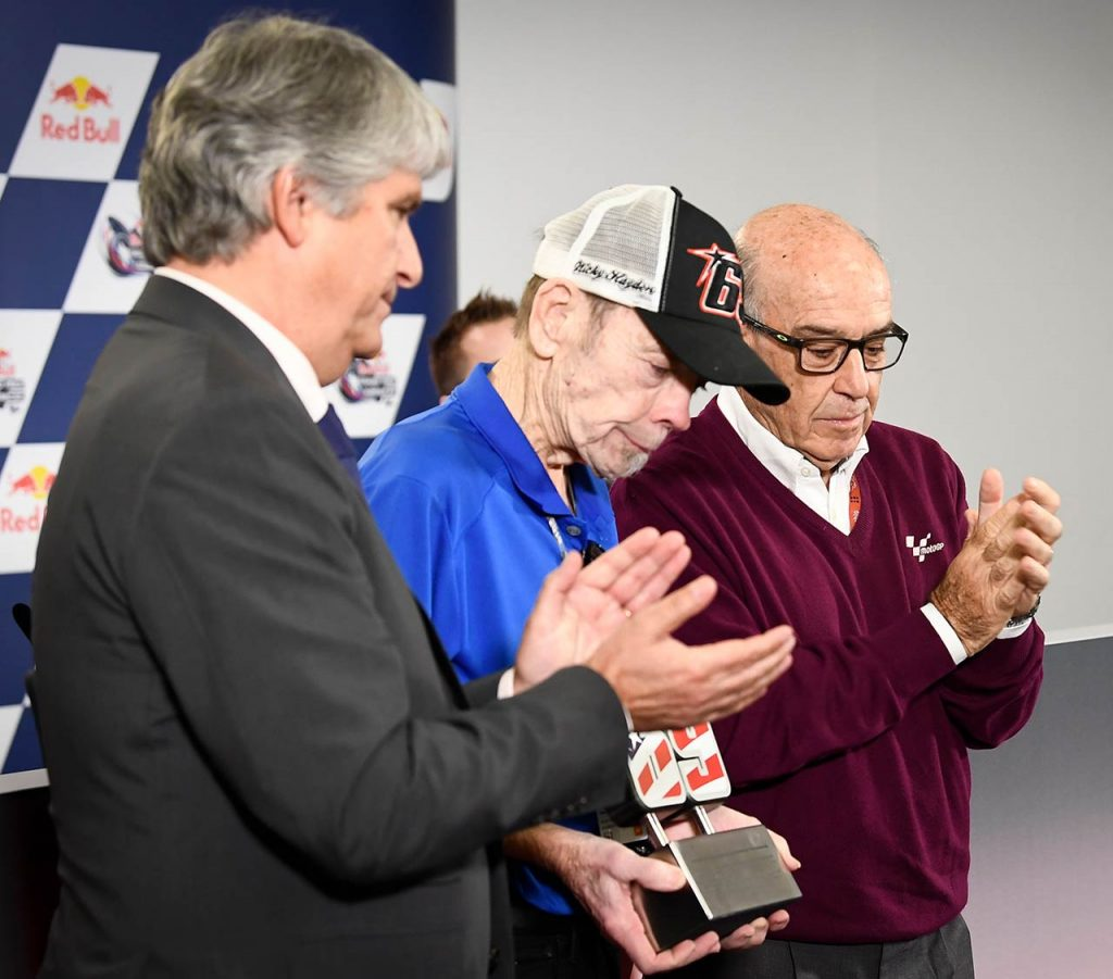 Nicky Hayden FIM President Jorge Viegas and Dorna CEO Carmelo Ezpeleta present Hayden father Earl with a commemorative number
