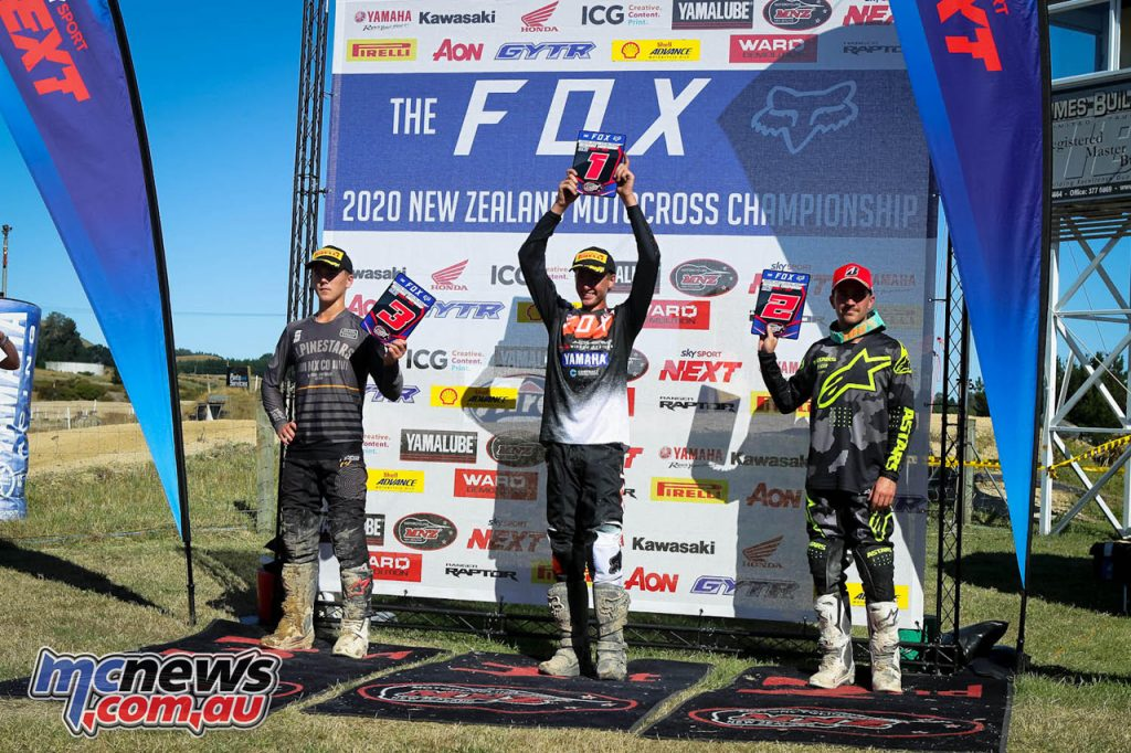 Altherm JCR Yamahas Maximus Purvis holds his Fox New Zealand Motocross Championships MX trophy aloft.