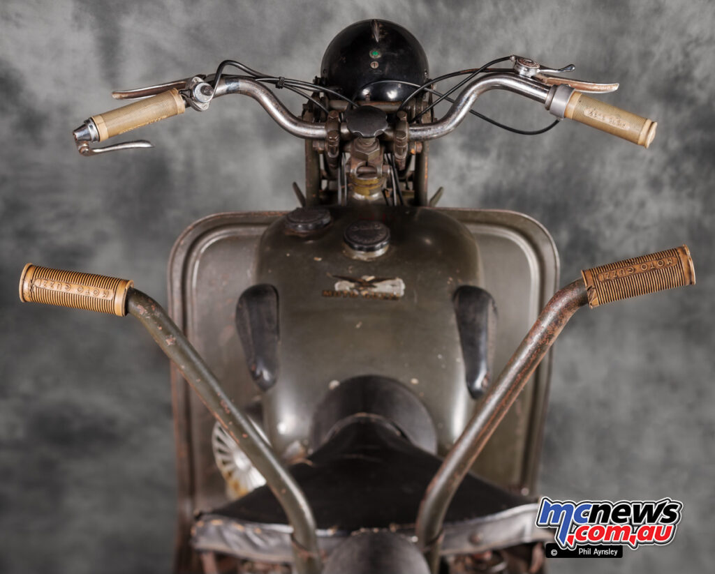 automatic advance magneto ignition was introduced in 1952, with the secondary bars for a pillion