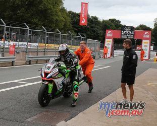 BSB Showdown Oulton Park Leon Haslam pushing his broken bike up the pitlane during qualifying ImageDyeomans