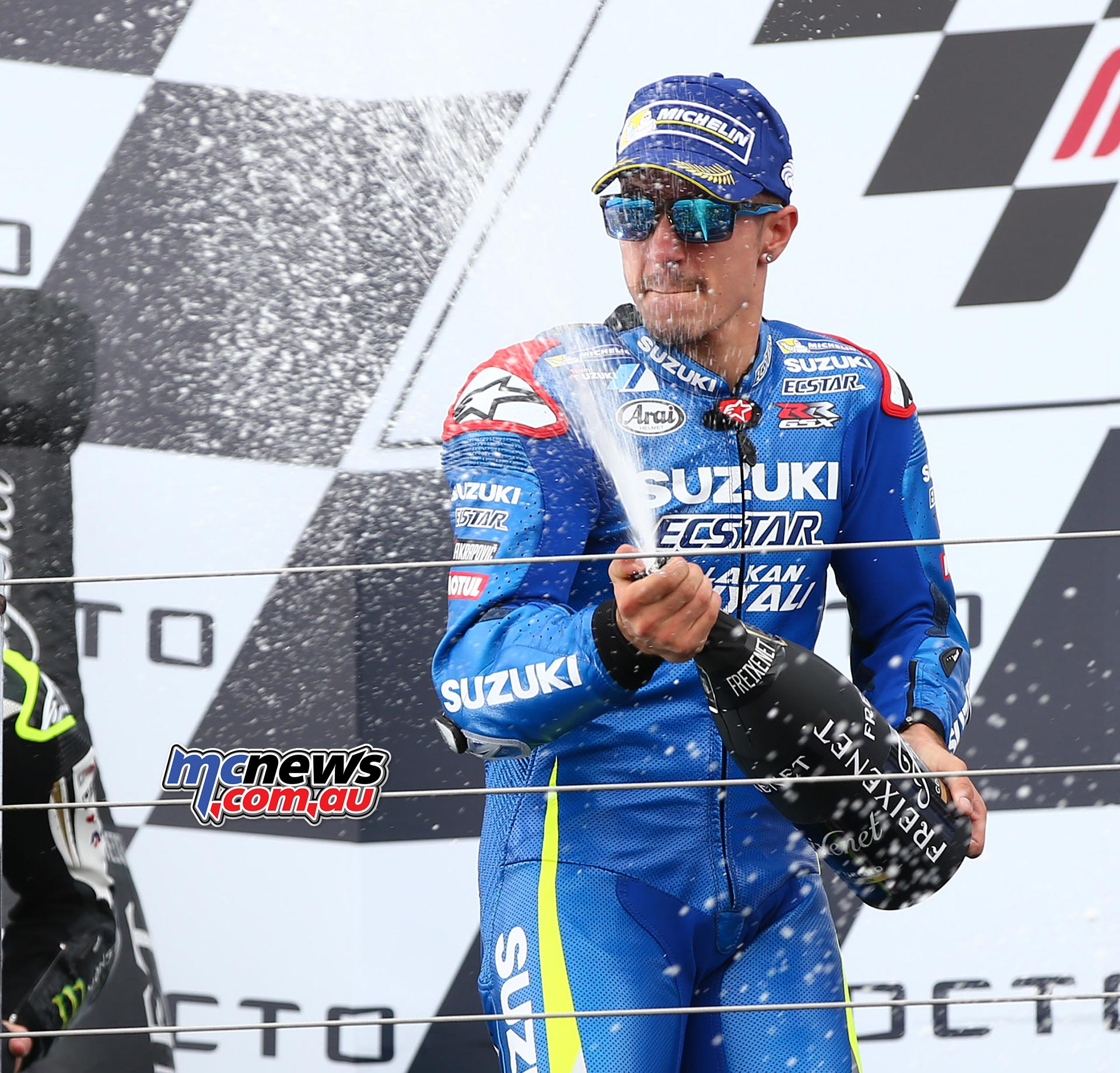 Maverik Vinales sprays the champagne at Silverstone in 2016 after taking Suzuki's first victory in almost a decade. Image by AJRN
